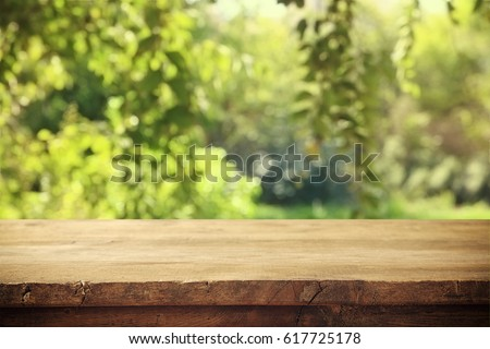 Empty rustic table in front of countryside background. product display and picnic concept