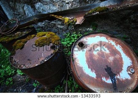 Empty rusting toxic chemical barrels