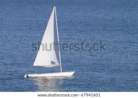 Empty Sailboat sailing with blue sea
