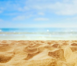 Empty sand beach in front of summer sea  with copy space