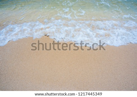 Empty sand beach with wave background. Summer Vacation Travel and Holiday concept #1217445349