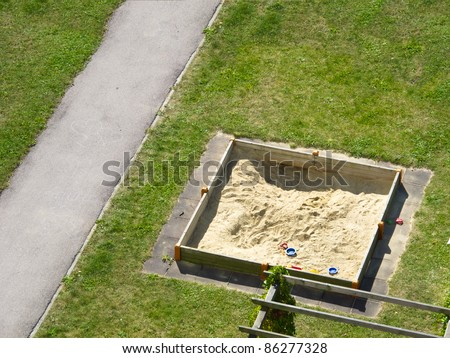 Empty sand box with toys