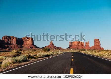 Empty scenic highway in Monument Valley, Arizona, USA - Shutterstock ID 1029826324