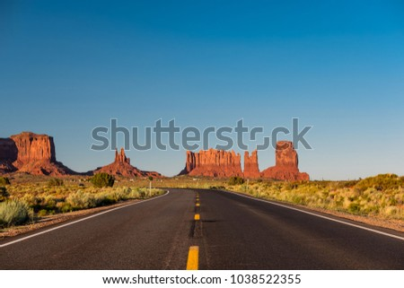 Empty scenic highway in Monument Valley, Arizona, USA - Shutterstock ID 1038522355