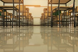 Empty School classroom with desks chair wood, and green board in high school Thailand, vintage tone education concept
