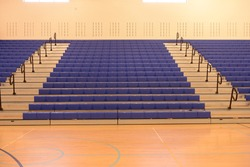 Empty school gym bleachers stands