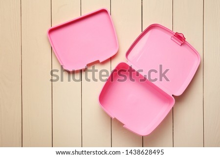 Empty school lunch box on white wooden background #1438628495