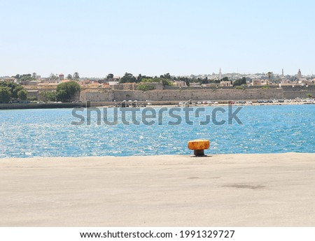 empty sea port with large hooks for mooring an empty ship ストックフォト ©