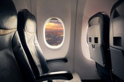 Empty seat on airplane while covid-19 outbreak destroy travel and airline business, health care and travel concept. Focus on window.