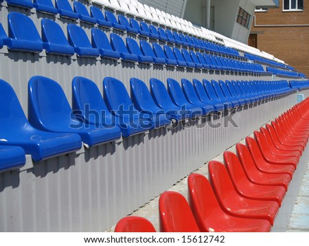 Empty seat rows of white blue and red