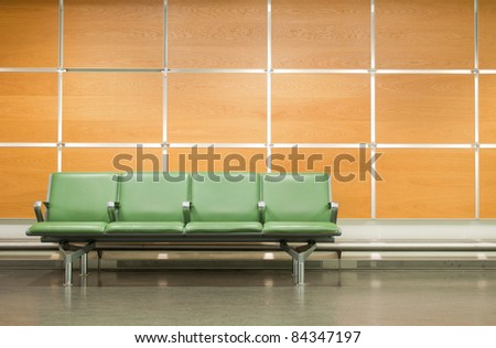 empty seats at a business building against a wooden wall (gorgeous interior setting)