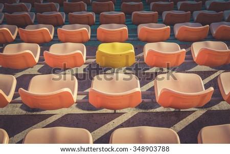 Empty seats at soccer stadium , vintage