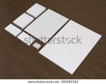Empty set of corporate identity templates. Business cards, blocks of papers and eraser.