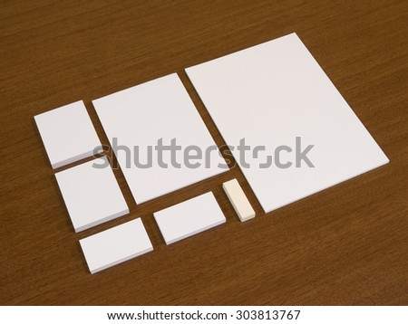 Empty set of corporate identity templates. Stationery with business cards, blocks of papers and eraser.