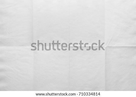 Empty sheet of paper folded in eight, texture background