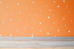 empty shelf and orange wall in kids room