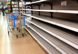 Empty shelves at a supermarket due to stockpiling during the coronavirus pandemic