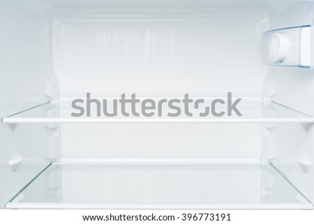 Empty shelves in refrigerator. Diet and hunger concept