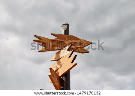 Empty sign pointers with a space for text. Wooden pointers on a wooden pole. #1479170132