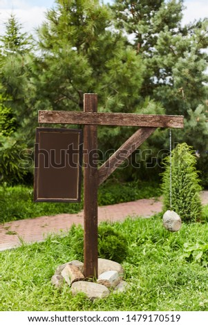 Empty sign pointers with a space for text. Wooden pointers on a wooden pole. #1479170519