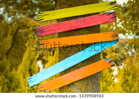 Empty signs pointers with space for text against background of autumn color. Five bright boards. School concept. Orange signboard #1439908943