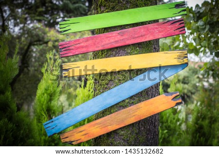 Empty signs pointers with space for text. Five bright boards green lime red yellow blue orange colors. Signboard on nature background #1435132682