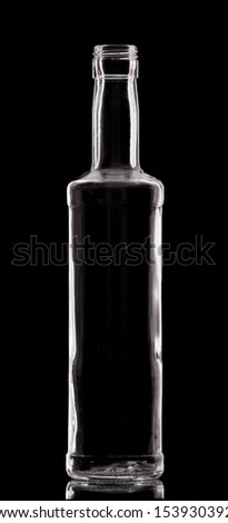 Empty single bottle with nice design on black. - stock photo