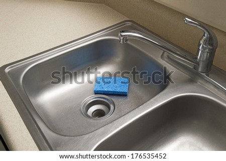 Empty Sink With Blue Sponge/ Horizontal Shot/ Stainless Steel Kitchen Sink/ Blue Sponge