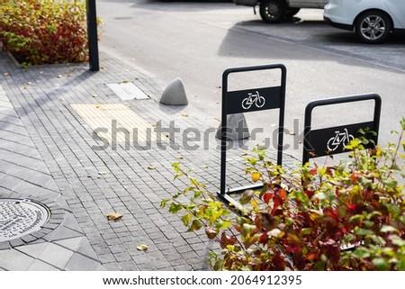 empty small bike parking near the road
