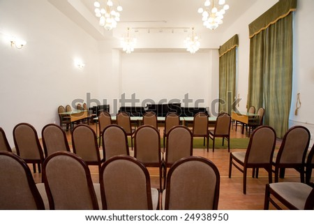 empty small concert room with piano