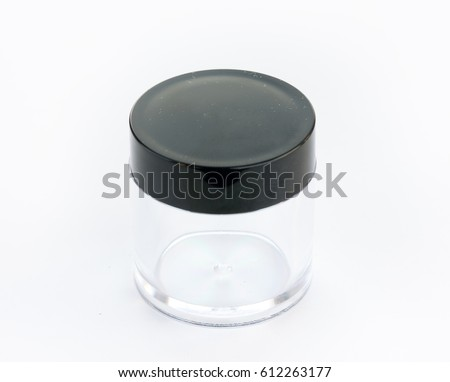 Empty small plastic or glass jar with black lid isolated on white background