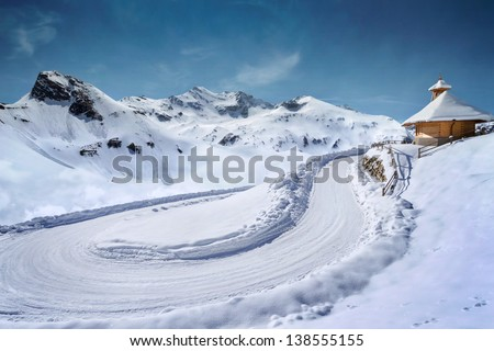 Empty snow covered mountain road in winter landscape #138555155