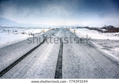 Empty snowy highway, beautiful wintertime landscape, amazing panoramic view, cold weather in Iceland, Scandinavia