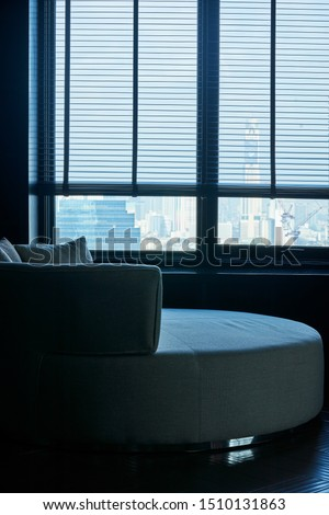 empty sofa near the window and light from outsite feel lonely background