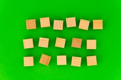 empty space for your text on wooden cubes on green background. any three words for an advertising slogan. the first word - six letters, the second - five letters, the third - five letters