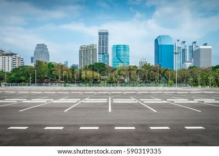 Empty space in city park outdoor asphalt parking lot #590319335