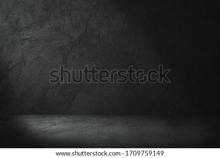 Empty space of Studio dark room concrete floor grunge texture background with light shading.