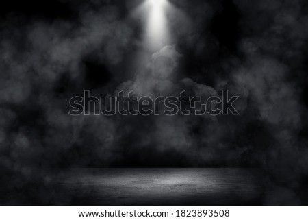 Empty space of Studio dark room concrete floor grunge texture background with spot lighting and fog or mist in background.