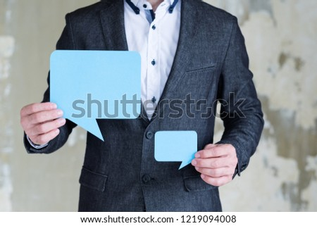 empty speech bubbles in man hands. social media business communication discussion dialogue concept. #1219094008
