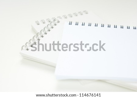 empty, spiral notebooks on white office table, shallow depth of field