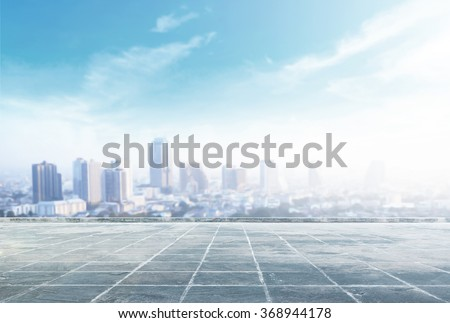 Empty square and floor with blurred aerial view of Bangkok skyline on amazing beauty sunlight. Beautiful hotel, resident of Bangkok, Thailand, Asia. Abstract blur big city background concept.