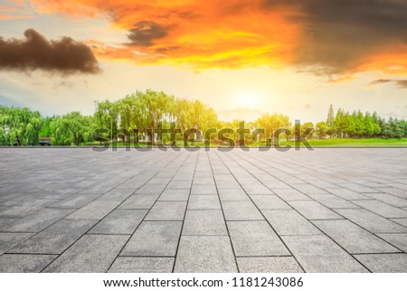 Empty square floor and green forest natural scenery at sunset #1181243086