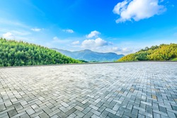 Empty square floor and green mountain with bamboo forest natural landscape.