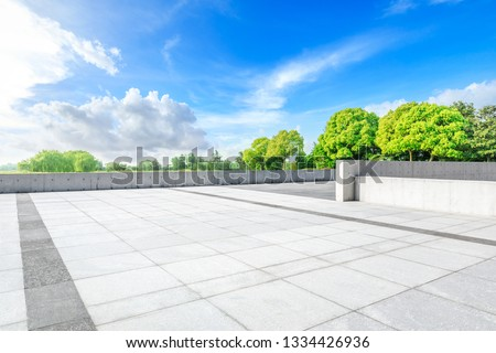 Empty square floor and green woods in nature park #1334426936