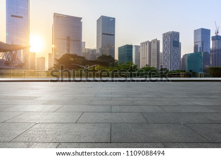 Empty square floor and modern commercial building at sunrise in Shenzhen #1109088494
