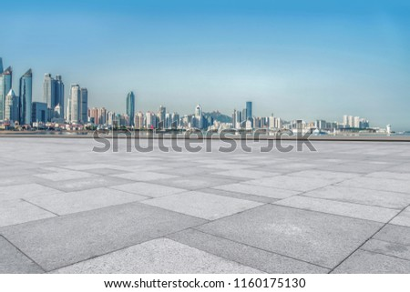 Empty square floor tiles and urban architectural landscape #1160175130