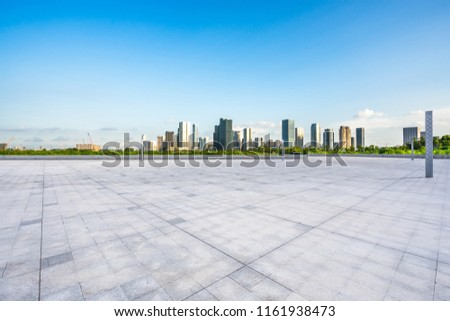 empty square with city skyline #1161938473