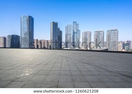 empty square with city skyline #1260621208