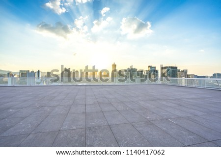 empty square with city skyline in hangzhou china