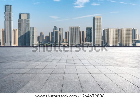empty square with city skyline in hangzhou china #1264679806